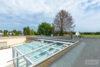 Köln: Bungalow mit 106 m² Wohnfläche + 35 m² Wintergarten | große Ausbaureserve | Feldblick uvm. - Flachdach mit ausreichend Platz für eine Solaranlage